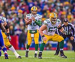 14 December 2014: Green Bay Packers quarterback Aaron Rodgers takes a snap in the fourth quarter against the Buffalo Bills at Ralph Wilson Stadium in Orchard Park, NY. The Bills defeated the Packers 21-13, snapping the Packers' 5-game winning streak and keeping the Bills' 2014 playoff hopes alive. Mandatory Credit: Ed Wolfstein Photo *** RAW (NEF) Image File Available ***
