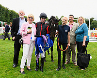 Connections of Field of Vision in the winners enclosure after winning the Peter Symonds Catering Handicap (Class 5),    during Afternoon Racing at Salisbury Racecourse on 7th August 2017