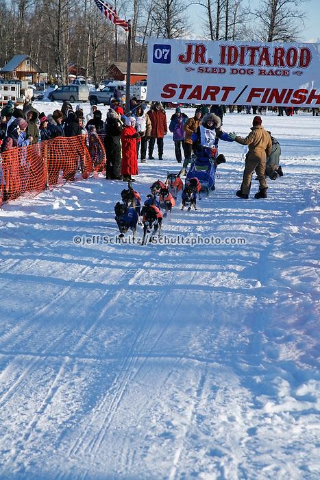 Saturday, February 24th, Knik, Alaska.  Jr. Iditarod musher Rohn Buser leaves start line on Knik Lake