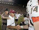 FSU Coach Bobby Bowden shakes hands with UMs outside linebacker Eric Winston after FSU defeatyed the Hyurricanes 10-7 at Bobby Bowden field oin Tallahassee September 5, 2005.   (Mark Wallheiser/TallahasseeStock.com)