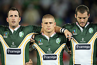 PICTURE BY VAUGHN RIDLEY/SWPIX.COM - Rugby League - Rugby League World Cup 2008 - Ireland v Fiji - Skilled Park, Gold Coast, Australia - 10/11/08...Copyright - Simon Wilkinson - 07811267706...Ireland's Ged Corcoran, Michael McIllorum and Simon Finnigan.