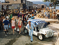 BNPS.co.uk (01202 558833)<br /> Pic: <br /> <br /> Even James Bond occasionally travelled by Moke...<br /> <br /> The 1960s cult-classic Mini Moke car has been reimagined as an electrically powered beach buggy. <br /> <br /> The original was based on the iconic Mini and produced as a light military vehicle but became popular among the wealthy as a runabout in tropical locations around the world.  <br /> <br /> Celebrity owners included Brigitte Bardot, Princess Margaret, Emperor Rosko and the Beach Boys.  <br /> <br /> The 21st century incarnation, the E-Moke, still boasts the same fantastic 1960s styling but is battery powered and fitted with modern luxuries such as power steering and a modern sound system. <br /> <br /> Offered in seven different colours, the electrically powered vehicle costs &pound;12,500. A gas powered version is also available for a pricier &pound;19,000.