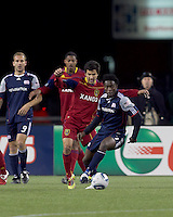 New England Revolution forward Kenny Mansally (7) dribbles as Real Salt Lake defender Tony Beltran (2) defends. In a Major League Soccer (MLS) match, Real Salt Lake defeated the New England Revolution, 2-0, at Gillette Stadium on April 9, 2011.