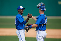 Dunedin Blue Jays relief pitcher Dany Jimenez (43) shakes hands with catcher Riley Adams (21) after closing out a Florida State League game against the Clearwater Threshers on April 7, 2019 at Jack Russell Memorial Stadium in Clearwater, Florida.  Dunedin defeated Clearwater 2-1.  (Mike Janes/Four Seam Images)
