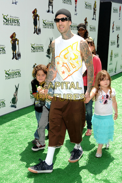 "TRAVIS BARKER & CHILDREN .Attending the ""Shrek Forever After"" Los Angeles Film Premiere held at the Gibson Amphitheatre, Universal City, California, USA, 16th May 2010..arrivals full length sleeveless white top vest tattoos baggy shorts hat sunglasses black beanie trainers kids son daughter family holding hands socks .CAP/ADM/BP.©Byron Purvis/AdMedia/Capital Pictures."