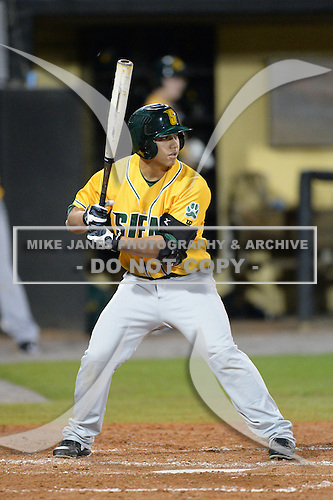 Siena Saints outfielder Andres Ortiz (3) during the season opening game against the Central Florida Knights at Jay Bergman Field on February 14, 2014 in Orlando, Florida.  UCF defeated Siena 8-1.  (Copyright Mike Janes Photography)