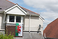 STORY BY STEVEN MORRIS SWANSEA, UK. 5th July 2015. A Welsh flag adorns a house in Mayhill, the area of Swansea that Wales manager Chris Coleman comes from.