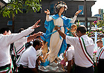 The statue of the Virgin Mary is hoisted onto a rolling platform in preparation for the Our Lady of the Most Holy Rosary's Feast of the Assumption procession in Cleveland, Ohio's Little Italy neighborhood on Sunday, Aug. 15, 2010.