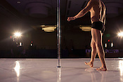 A male pole competitor walks on stage to warm up for the 2014 Atlantic Pole Championships in Herndon, Va. on April 12, 2014. CREDIT: Lance Rosenfield/Prime for The Washington Post