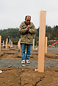 Onagawa, Japan - A photo made available on April 11 shows Yoshikatsu Hiratsuka, 66, pray in front of his wife's grave at a temporary mass grave for the March 11 earthquake and tsunami victims. Yoshikatsu was visiting a friend at the time the earthquake hit and he quickly rushed back home to later see his wife and mother in front of the house thinking how to escape. Before the two could react to a plan to escape, the 10-meter tsunami swept them away, leaving Yoshikatsu to live. His son is still missing and continues to search for him everyday. (Photo by Christopher Jue/AFLO) [2331] **ITALY OUT**