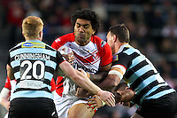 Picture by Alex Whitehead/SWpix.com - 01/05/2014 - Rugby League - First Utility Super League - St Helens v London Broncos - Langtree Park, St Helens, England - St Helens' Mose Masoe is tackled by London's James Cunningham and Nick Slyney.