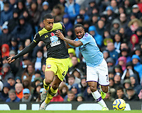 2nd November 2019; Etihad Stadium, Manchester, Lancashire, England; English Premier League Football, Manchester City versus Southampton; Raheem Sterling of Manchester City fends off Yan Valery of Southampton - Strictly Editorial Use Only. No use with unauthorized audio, video, data, fixture lists, club/league logos or 'live' services. Online in-match use limited to 120 images, no video emulation. No use in betting, games or single club/league/player publications