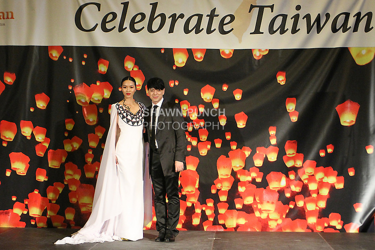 Taiwan born fashion designer, Malan Breton poses with model for the close of his Spring 2015 collection fashion show, for the Celebrate Taiwan event in Grand Central Terminal on September 27, 2014.