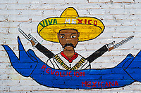 A painted artwork, depicting Mexican Revolution leader Emiliano Zapata and saying 'Viva Mexico', appears on the brick wall in a village in the mountains of Nayarit, Mexico, 21 April 2011.