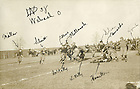 "GATH 24/17:  Football Game Scene - Notre Dame vs. Wabash, 1909/1120.  Notre Dame offensive play including Harry ""Red"" Miller, William Schmitt, Joe Collins, George Philbrook, Al ""Red"" Kelly, Luke Kelly, Don Hamilton, Sam ""Rosey"" Dolan, Howard ""Cap"" Edwards, Ed Lynch.  Image from the University of Notre Dame Archives."