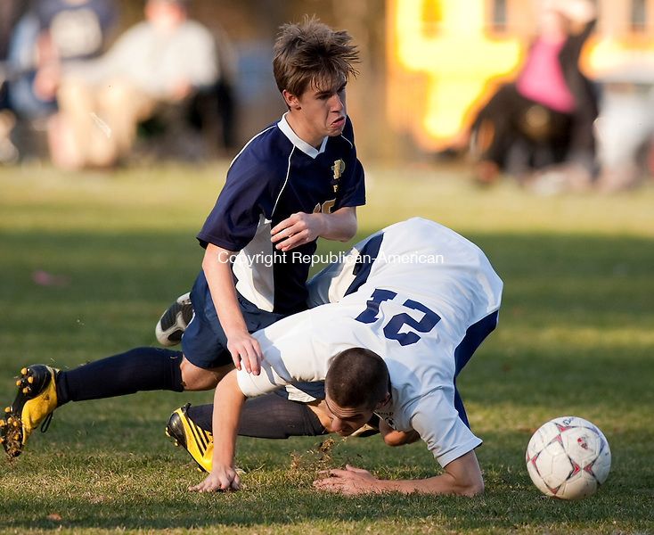 OXFORD, CT, 19 OCTOBER 2010-101910JS10-Oxford's Steven Parkin (21) and Notre Dame-Fairfield's David Desimore (19) hit the ground after colliding while going for the ball during their game Tuesday at Oxford High School. <br />  Jim Shannon Republican-American