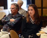 LANGHORNE, PA -  OCTOBER 24: Caitlin Grabowski (R), 12, a student at St. Andrews School in Newtown listens to a speaker at the Langhorne Rotary luncheon October 24, 2013 in Langhorne, Pennsylvania. 5 young ladies spoke about Financial Literacy programs at Saint Andrews school in Newtown Township. (Photo by William Thomas Cain/Cain Images)