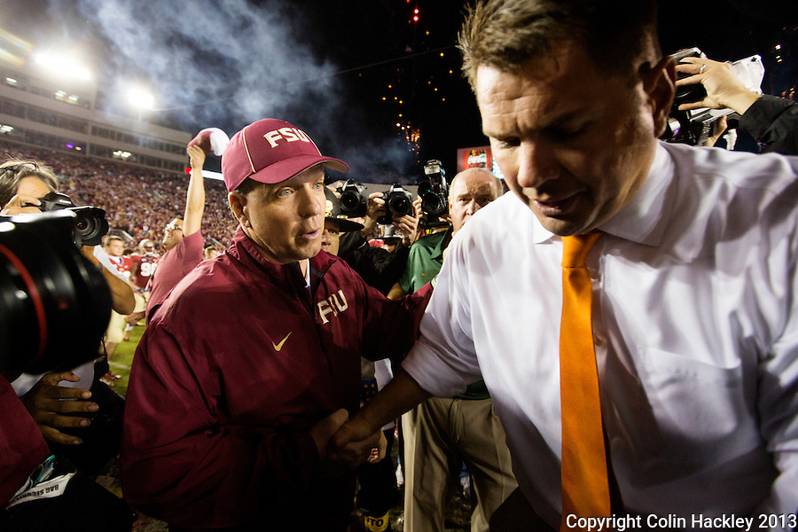TALLAHASSEE, FL 11/2/13-FSU-MIAMI110213CH-Florida State Head Coach Jimbo Fisher, left, greets University of Miami Head Coach Jeff Golden at midfield after the game Saturday at Doak Campbell Stadium in Tallahassee. The Seminoles beat the Hurricanes 41-14.<br /> COLIN HACKLEY PHOTO