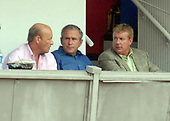 Washington, D.C. - July 4, 2007 -- United States President George W. Bush watches the Chicago Cubs play the Washington Nationals at RFK Stadium in Washington on Thursday, July 7, 2007. With Bush, center, are Nationals President Stan Kasten, left, and Nationals General Manager Jim Bowden, right. <br /> Credit: Roger L. Wollenberg - Pool via CNP