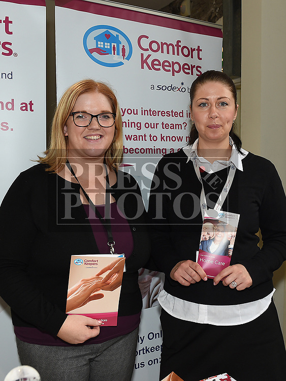 Aisling McCabe and Anete Sinkevica from Comfort Keepers at the Bank of Ireland Expo held in the old church Ardee. Photo:Colin Bell/pressphotos.ie