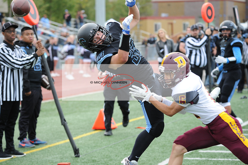Chugiak's Bryant White narrowly misses a pass. Photo by Michael Dinneen for the Star.