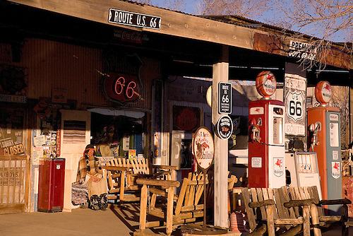 AN OLD GAS STATION PROUDLY DISPLAYS ITS LOCATION ON THE FAMOUS ROUTE 66 IN ARIZONA, ONE OF AMERICA'S FIRST TRANS NATIONAL HIGHWAYS