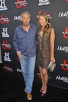 Kevin Costner and Christine Baumgartner at the Los Angeles premiere of 'Hatfields & McCoys' at Milk Studios on May 21, 2012 in Los Angeles, California. © mpi35/MediaPunch Inc.
