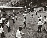 PANAMA, David, Guadalupe, boys play baseball at a grade school in the mountain town of Guadalupe, across the street from the Los Quetzales Lodge, Central America (B&W)