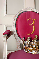 The signature of Les 3 Garcons is embroidered on the back of a Louis XVI chair