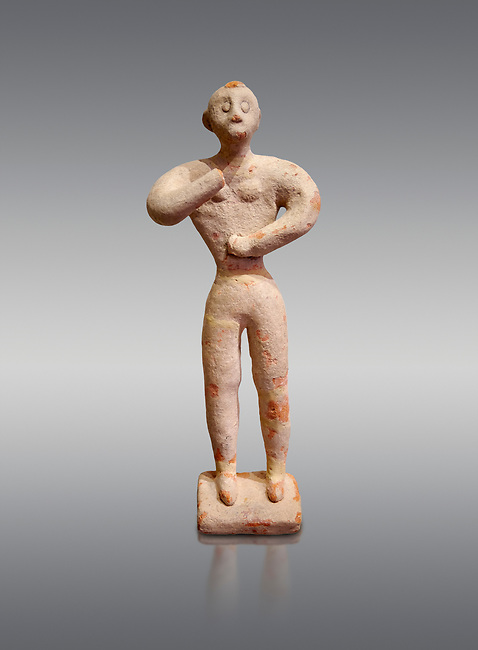 Minoan clay male figurine in the attitude of worship, Chamezi 1900-1700 BC; Heraklion Archaeological  Museum, grey background.