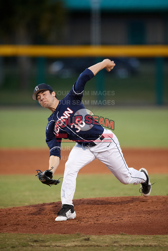 UConn Huskies starting pitcher Tim Cate (36) closes his eyes as he delivers a pitch during a game against the USF Bulls on March 23, 2018 at USF Baseball Stadium in Tampa, Florida.  UConn defeated USF 6-4.  (Mike Janes/Four Seam Images)