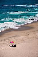 Locals sitting On The Sand In Laguna Beach