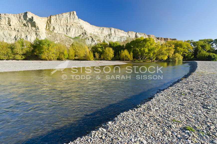 Early morning light on clay cliffs at the edge of the Manuherikia River near Alexandra in Central Otago, South Island, New Zealand.