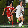 Sacred Heart No. 16 Caroline Mcermott, right, gets pressured by St. John the Baptist No. 9 Stephanie Sheridan during a CHSAA varsity girls' soccer game at Sacred Heart Academy on Monday, October 5, 2015. Sacred Heart won by a score of 3-1.<br /> <br /> James Escher