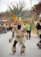 NWA Media/ANDY SHUPE - Leonardo Lopez of Springdale dances while taking part in the ninth-annual pilgrimage walk to celebrate The Feast of Our Lady of Guadalupe Sunday, Dec. 14, 2014, in Fayetteville. Parishioners walked from St. Joseph Catholic Church in Fayetteville to St. Raphael Church in Springdale. Visit nwamedia.photoshelter.com to see more photos from the event.