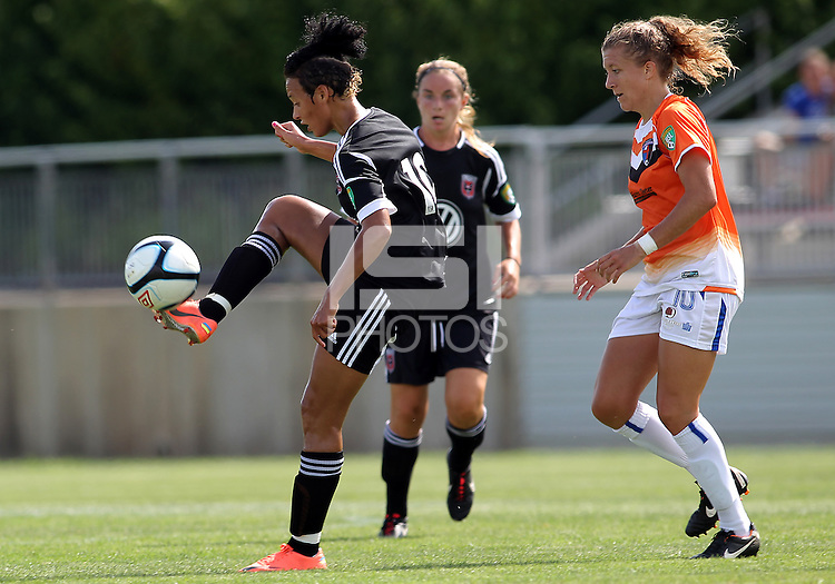 BOYDS, MARYLAND - July 22, 2012:  Lianne Sanderson (10) of DC United Women passes the ball away from Kelsey Fenix (10) of the Charlotte Lady Eagles during the W League Eastern Conference Championship match at Maryland Soccerplex, in Boyds, Maryland on July 22. DC United Women won 3-0.