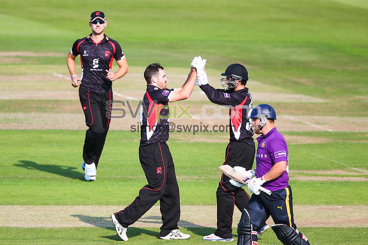 Picture by Alex Whitehead/SWpix.com - 01/07/2014 - Cricket - NatWest T20 Blast - Yorkshire Vikings v Leicestershire Foxes - Headingley Cricket Ground, Leeds, England - Leicestershire's Ben Raine (second left) is congratulated by Ned Eckersley (second right) on bowling Yorkshire's Aaron Finch (right).