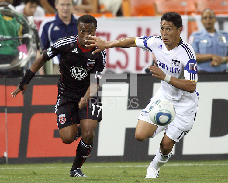 Boyzzz Khumalo #17 of D.C.United and Roger Espinoza #17 of the Kansas City Wizards run after a loose ball during an MLS match at RFK Stadium on May 5 2010, in Washington DC. United won 2-1