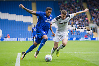 Nathaniel Mendez-Laing of Cardiff City takes on Craig Forsyth of Derby County during the Sky Bet Championship match between Cardiff City and Derby County at Cardiff City Stadium, Cardiff, Wales on 30 September 2017. Photo by Mark  Hawkins / PRiME Media Images.