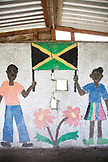 JAMAICA, Port Antonio. Children's mural in a bus stop.