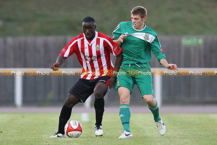 Tambeson Eyong (L) of Hornchurch and Michael Peacock of Hendon - AFC Hornchurch vs Hendon - Ryman League Premier Division Football at The Stadium - 18/09/10 - MANDATORY CREDIT: Gavin Ellis/TGSPHOTO - Self billing applies where appropriate - Tel: 0845 094 6026