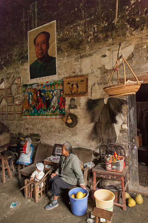 The main living area of a villager's home in Guangxi province is basic but rich in character.