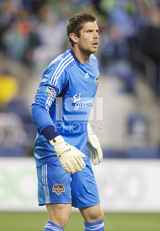 Houston Dynamo goalkeeper Tally Hall watches the pitch during play against the Seattle Sounders FC at Qwest Field in Seattle Friday March 25, 2011. The match ended in a 1-1 draw.