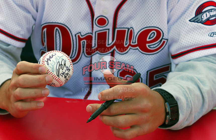 April 8, 2009: Infielder Anthony Rizzo of the Greenville Drive, Class A affiliate of the Boston Red Sox, signs an autograph for a fan during Media Day at Fluor Field at the West End in Greenville, S.C. Photo by:  Tom Priddy/Four Seam Images