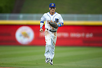 Durham Bulls center fielder Andrew Velazquez (11) jogs off the field between innings of the game against the Gwinnett Braves at Durham Bulls Athletic Park on April 20, 2019 in Durham, North Carolina. The Bulls defeated the Braves 11-3 in game one of a double-header. (Brian Westerholt/Four Seam Images)