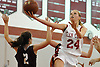 Grace Brady #24 of Glen Cove drives to the hoop during a varsity girls' basketball game against North Shore at Glen Cove High School on Friday, Dec. 18, 2015. Brady recorded 24 points and __ blocks in defeat as North Shore won by a score of 64-53.