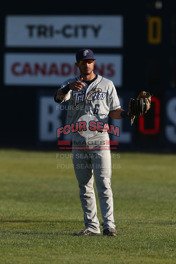 Kodie Tidwell (6) of the Tri-City Dust Devils throws before a game against the Vancouver Canadians at Nat Bailey Stadium on July 23, 2015 in Vancouver, British Columbia. Tri-City defeated Vancouver, 6-4. (Larry Goren/Four Seam Images)
