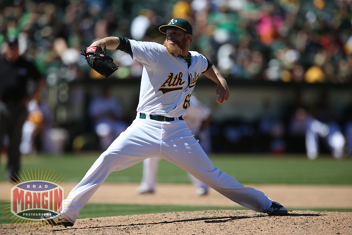 OAKLAND, CA - JULY 6:  Sean Doolittle of the Oakland Athletics pitches during the game against the Toronto Blue Jays at O.co Coliseum on Sunday, July 6, 2014 in Oakland, California. Photo by Brad Mangin