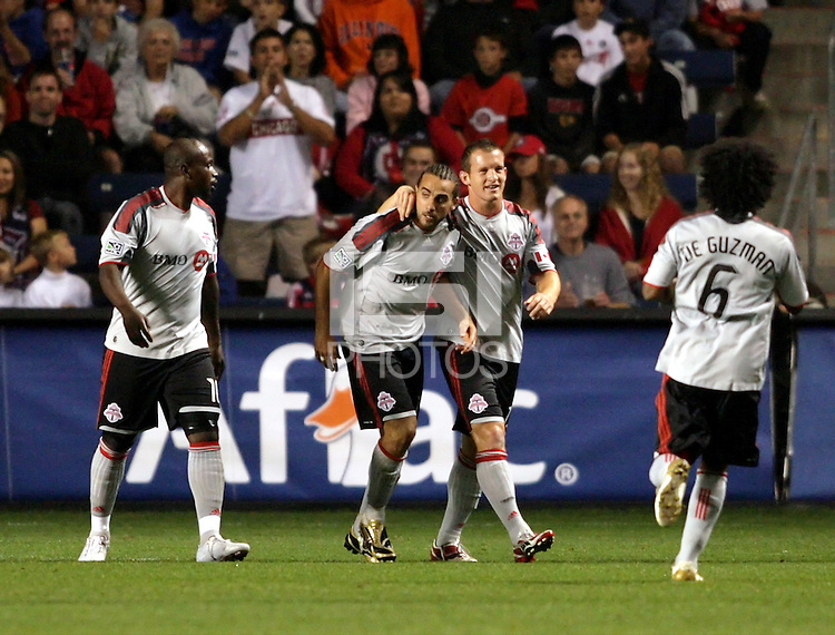 Toronto FC midfielder Dwayne De Rosario (14) is congratulated by forward Chad Barrett (19) after scoring Toronto FC's first goal.  The Chicago Fire tied Toronto FC 2-2 at Toyota Park in Bridgeview, IL on September 26, 2009.