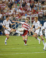 New England Revolution midfielder Any Dorman (25) gets a foot on the ball as FC Dallas midfielder Dax McCarty (13) and New England Revolution midfielder Jeff Larentowicz (13) attempt to gain control.  New England Revolution defeated FC Dallas 3-2 to capture the 2007 Lamar Hunt U.S. Open Cup at Pizza Hut Park in Frisco, TX on October 3, 2007.